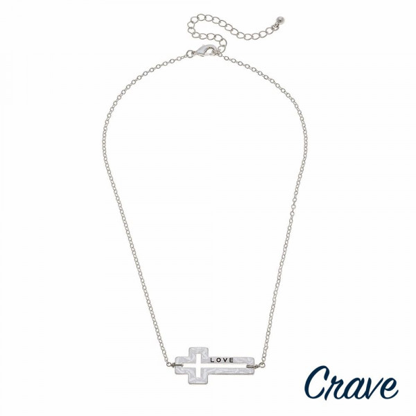 "Silver cable chain ""Love"" engraved east west cross necklace. Pendant approximately 1.5"" in length. Approximately 18"" in length overall."
