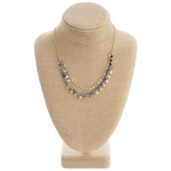 "Layered beaded disc necklace. Approximately 18"" in length."