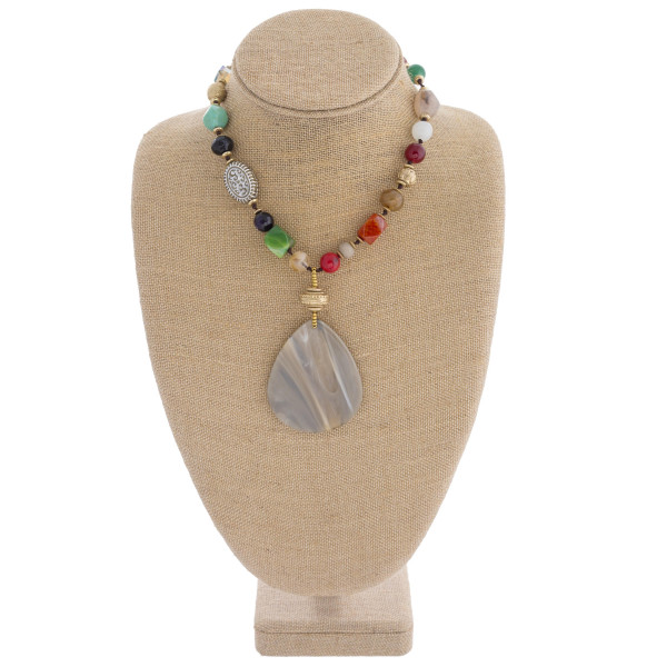 "Semi precious beaded statement necklace featuring a marble resin teardrop pendant. Pendant approximately 3"" in length. Approximately 26"" in length overall."