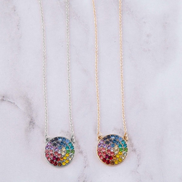 """Multicolor cubic zirconia disc pendant necklace. Pendant approximately .75"""" in diameter. Approximately 18"""" in length overall."""