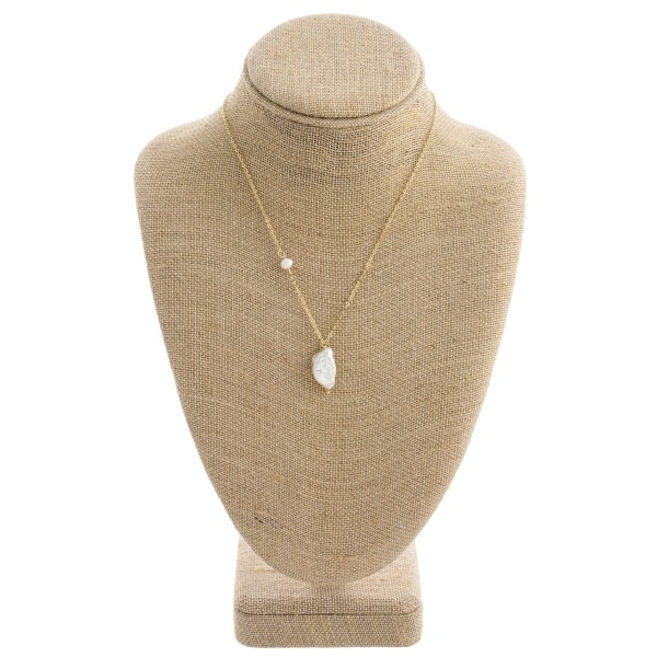 "Freshwater pearl pendant necklace with wire wrapping accents. Approximately 18"" in length."