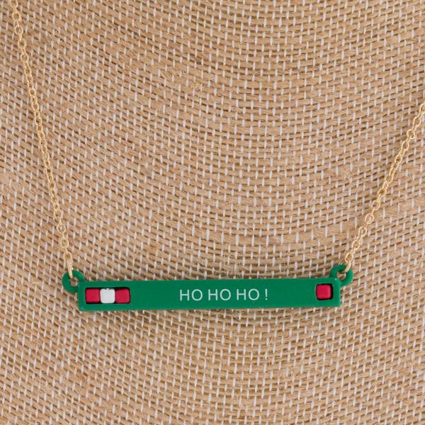 """Christmas """"Ho Ho Ho"""" bar necklace. Pendant approximately 2"""" in length. Approximately 16"""" in length overall."""