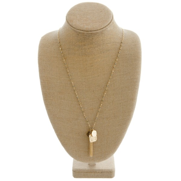 """Long beaded necklace featuring a chain linked charm tassel pendant.   - Pendant approximately 3"""" in length  - Approximately 36"""" in length overall"""