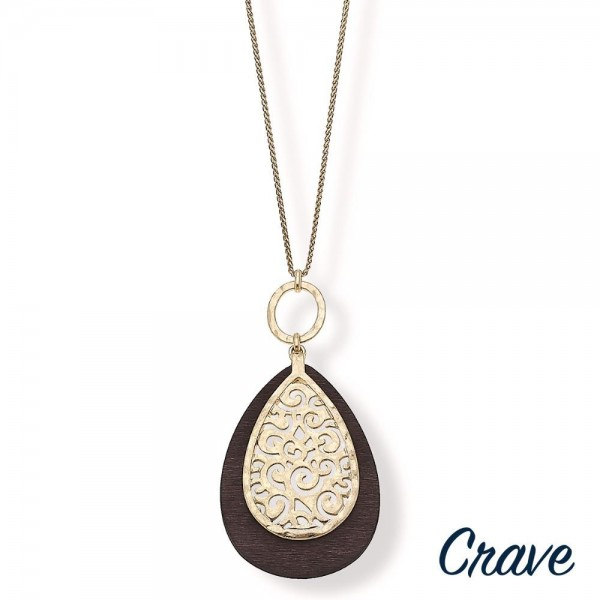 """Long metal filigree encased wood teardrop pendant necklace.   - Pendant approximately 3.75"""" in length - Approximately 36"""" L overall with 3"""" extender"""