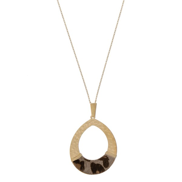 """Hammered teardrop pendant necklace with cowhide leopard print and wire wrapped details.  - Pendant approximately 3"""" in length - Approximately 36"""" in length overall"""