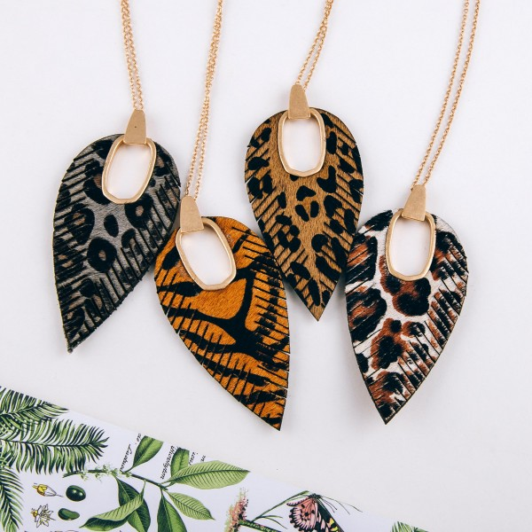 """Cowhide leopard print hinge cut out pendant necklace.  - Pendant approximately 4"""" in length - Approximately 38"""" in length overall"""