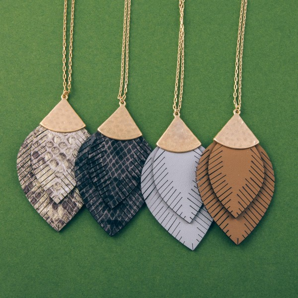 """Long doubled faux leather snakeskin feather pendant necklace.  - Pendant approximately 3.5"""" in length - Approximately 38"""" in length overall with 3"""" extender"""