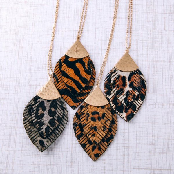 """Long doubled genuine leather animal print feather pendant necklace.  - Pendant approximately 3.5"""" in length - Approximately 36"""" in length overall with 3"""" extender"""