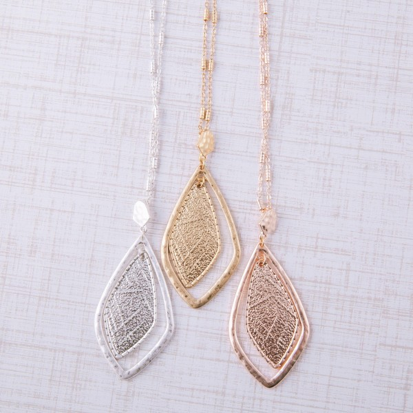 """Long textured nested pendant necklace.  - Pendant approximately 2"""" in length - Approximately 36"""" in length overall with 3"""" extender"""