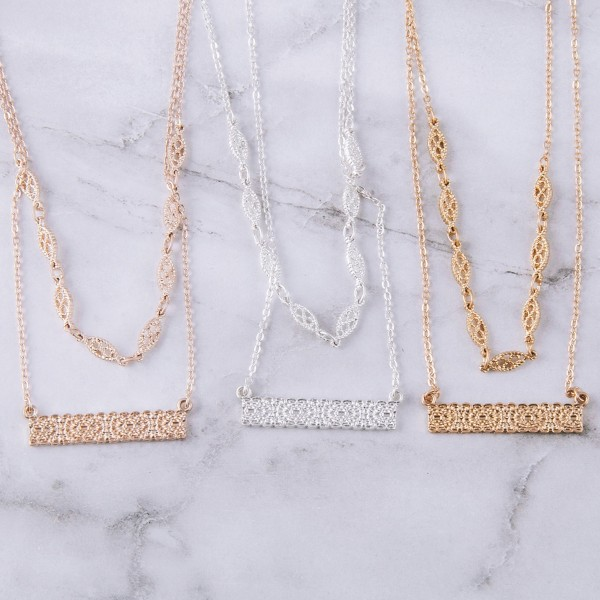 """Flower filigree textured layered bar necklace.  - Bar pendant approximately 1.25"""" in length - Shortest layer approximately 12"""" in length - Approximately 14"""" in length overall with 3.5"""" extender"""