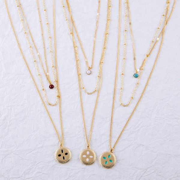 """Gold layered cut out flower pendant necklace.  - Shortest layer approximately 16"""" in length  - Approximately 22"""" in length overall with 2"""" extender"""