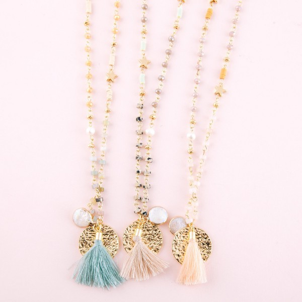 "Long multi semi precious beaded tassel necklace with star and pearl accents.  - Approximately 36"" L  - 3"" extender"
