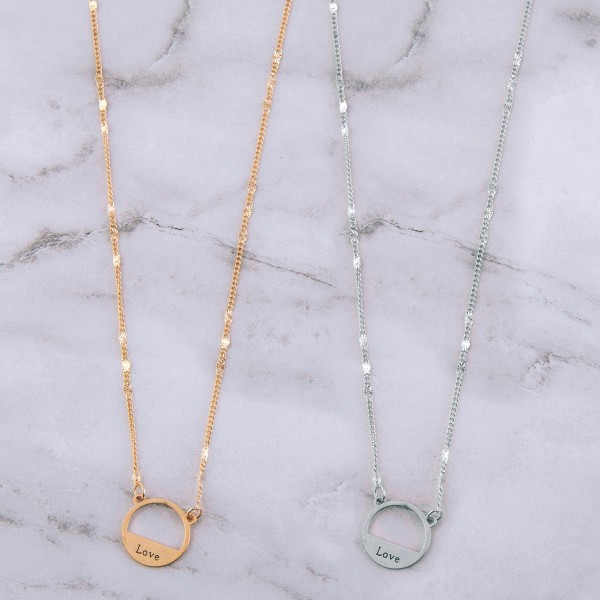 """Love engraved pendant necklace.  - Pendant approximately .5"""" in diameter - Approximately 14"""" in length overall with 3"""" extender"""