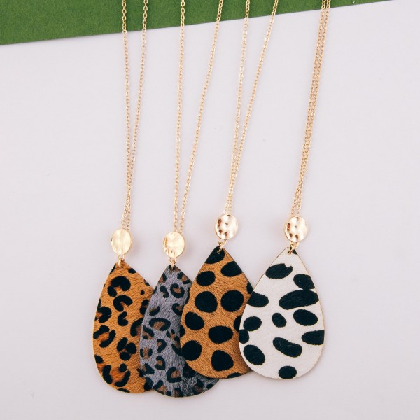 """Long genuine leather cowhide leopard print teardrop pendant necklace.  - Pendant approximately 3"""" in length - Approximately 34"""" in length overall with 3"""" extender"""