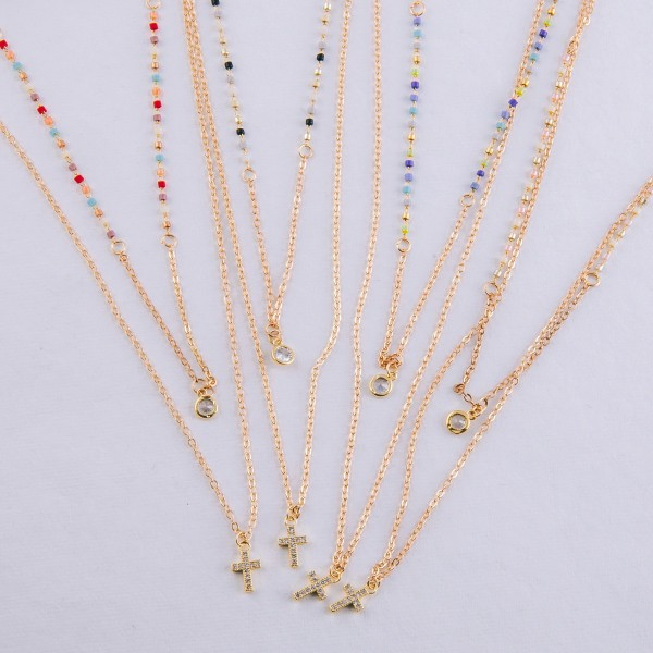 """Dainty seed beaded layered cubic zirconia cross necklace.  - Cubic Zirconia  - Approximately 18"""" in length overall with 3.5"""" extender"""