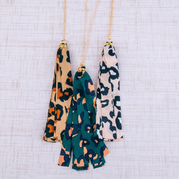 "Long leopard print fabric tassel pendant necklace.  - Pendant approximately 5"" in length - Approximately 40"" in length overall with 3"" extender"