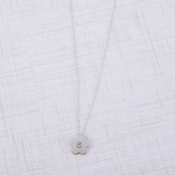 "Matte silver rhinestone flower pendant necklace.  - Pendant approximately .75"" in diameter - Approximately 18"" in length with 2.5"" extender"
