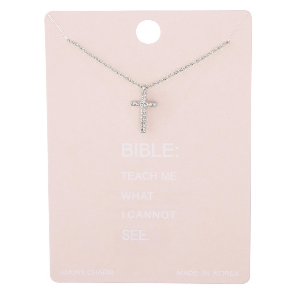 "Dainty rhinestone cross lucky charm necklace.  - Pendant approximately .5""  - Approximately 15"" L with 2"" extender"