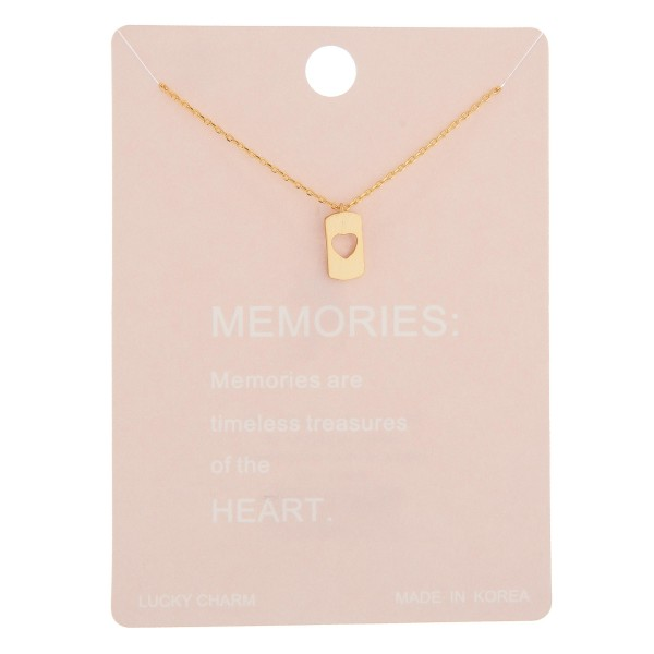 "Dainty memories lucky charm necklace with cut out heart details.  - Pendant approximately 1cm  - Approximately 16"" in length with 2"" extender"