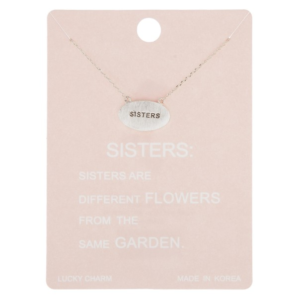 "Dainty sisters engraved lucky charm necklace.  - Pendant approximately .75""  - Approximately 16"" in length with 2"" extender"
