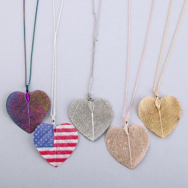 """White Gold dipped brass filigree heart pendant necklace.  - Pendant approximately 2""""  - Approximately 17"""" in length with 2"""" extender"""