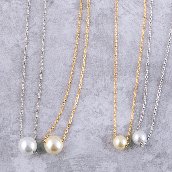 "Gold dipped pearl collar necklace.  - Pearl size approximately 5.5mm - Approximately 14"" in length with 1"" extender"