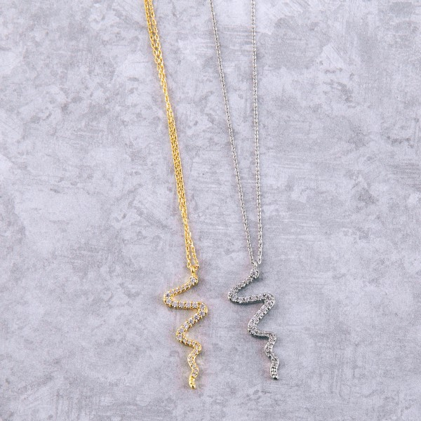 "Gold dipped cubic zirconia snake pendant necklace.  - Cubic Zirconia  - Pendant approximately 1"" in length - Approximately 15"" in length overall with 2"" extender"