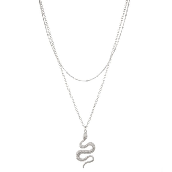 "Metal layered designer inspired snake pendant necklace.  - Pendant approximately 1.75""  - Shortest layer approx. 14""  - Approximately 20"" L  - 3"" extender"