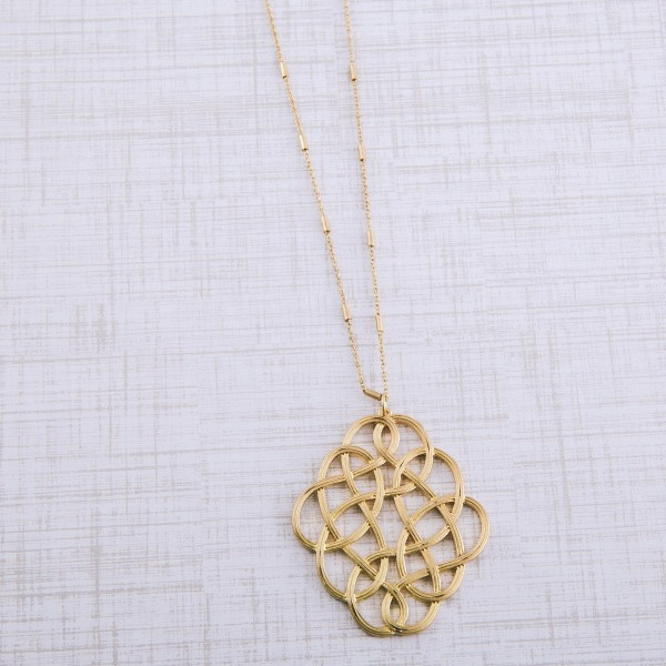 """Long metal filigree loop pendant necklace.  - Pendant approximately 2.5""""  - Approximately 32"""" L with 3"""" extender"""
