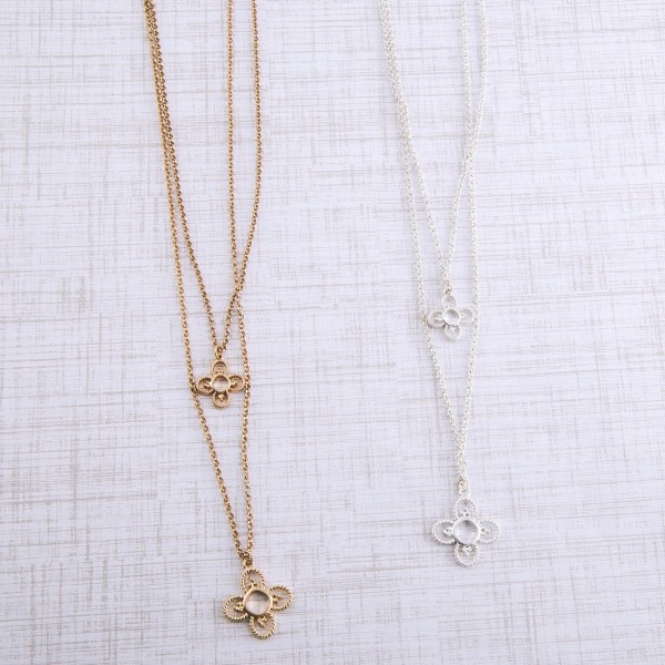 """Layered metal flower necklace.  - Small Pendant approximately .5""""  - Pendant approximately 1""""  - Shortest layer 16""""  - Approximately 20"""" L overall with 3"""" extender -"""