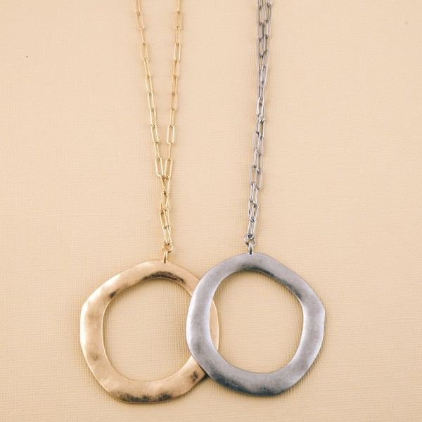 """Long hammered disc pendant necklace.  - Pendant approximately 2.5"""" in diameter - Approximately 36"""" L overall  - 3"""" extender"""