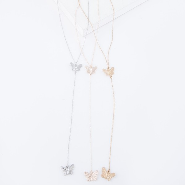 "Rose Gold Y necklace featuring a thin chain and butterfly pendants  - Approximately 16"" L, Y pendant is approximately 26"" L  - Features a 3"" extender"