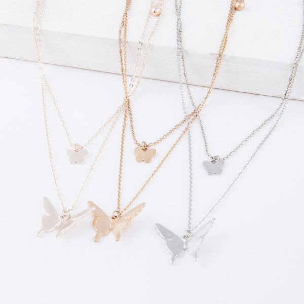 "Short Double layered rose gold necklace with butterfly pendants.  - Shorter chain measures approximately 14"" L & longer chain measures approximately 17"" L  - Features a 3.5"" extender"