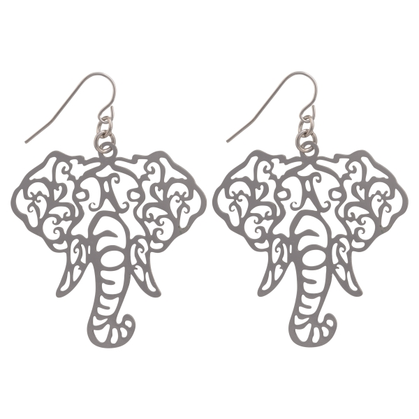 "Silver tone fishhook earrings featuring a cutout elephant head. Approximately 1 1/2"" in length."