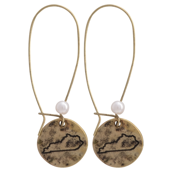 "Burnished gold tone fishhook earrings featuring a disk stamped with the state of Kentucky and a faux pearl accent. Approximately 1 1/2"" in length."