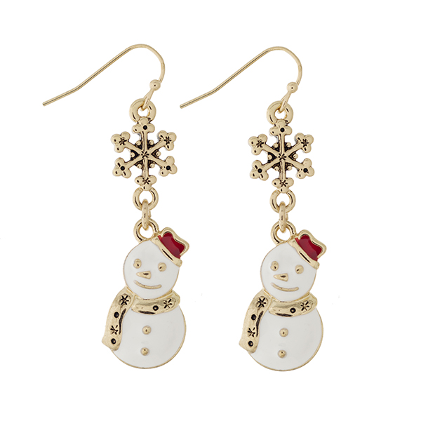 """Gold tone fishhook earrings displaying a snowflake charm with a dangling white snowman wearing a red hat. Charm approximately 1 1/2"""" in length. Overall length 2""""."""