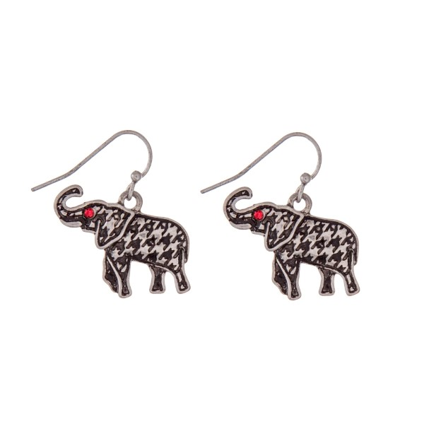 """Silver tone fishhook earrings with a houndstooth elephant and red rhinestones. Approximately 1"""" in length."""