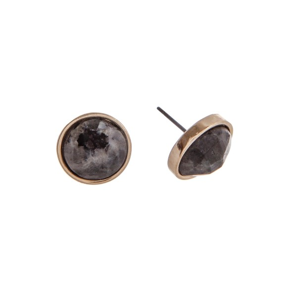"""Gold tone circle post earrings with a black lapis stone. Approximately 0.5"""" in diameter."""