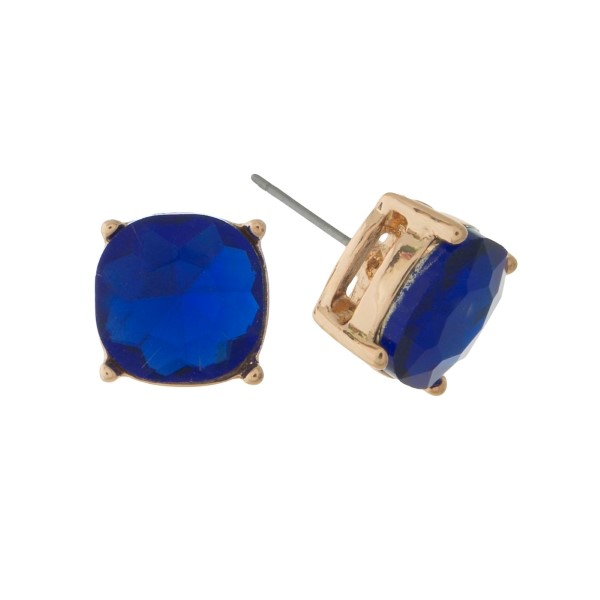 "Gold tone stud earrings with a royal blue rhinestone. Approximately 1/2"" in width."