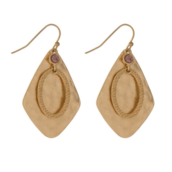 "Hammered gold tone fishhook earrings with a diamond shaped and a small pink stone. Approximately 1.25"" in length."