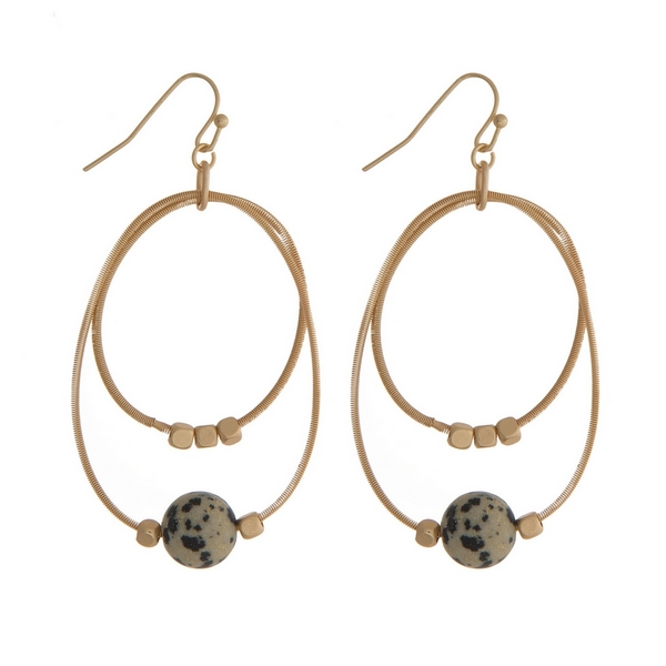 """Gold tone fishhook earrings with two open circles and gold tone and dalmatian jasper natural stone beads. Approximately 2"""" in length."""