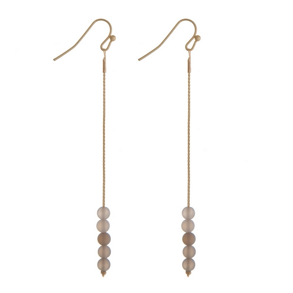"Gold tone fishhook earrings with gray natural stone beads. Approximately 3"" in length."