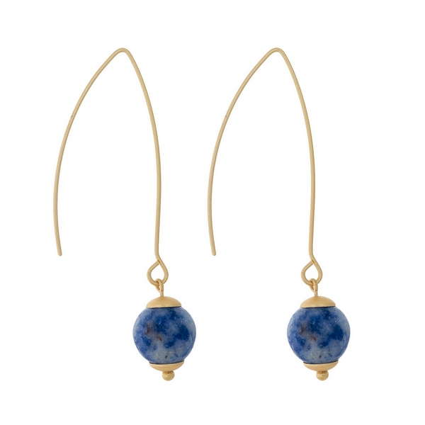 """Matte gold tone long hook earrings with a sodalite natural stone bead. Approximately 2"""" in length."""