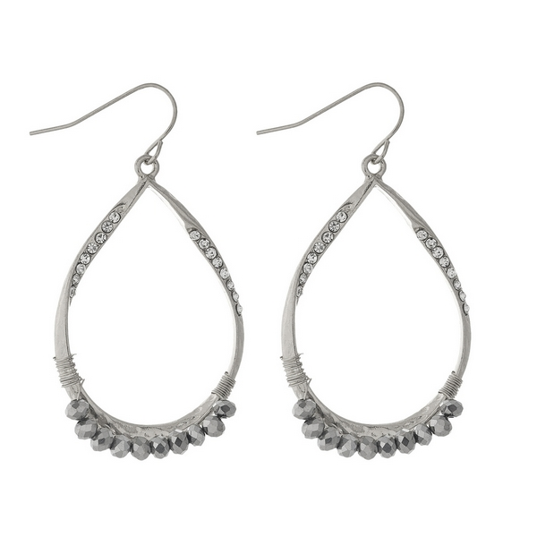 "Silver tone fishhook earrings featuring an open teardrop shape, clear rhinestones, and hematite wire wrapped beads. Approximately 2"" in length."