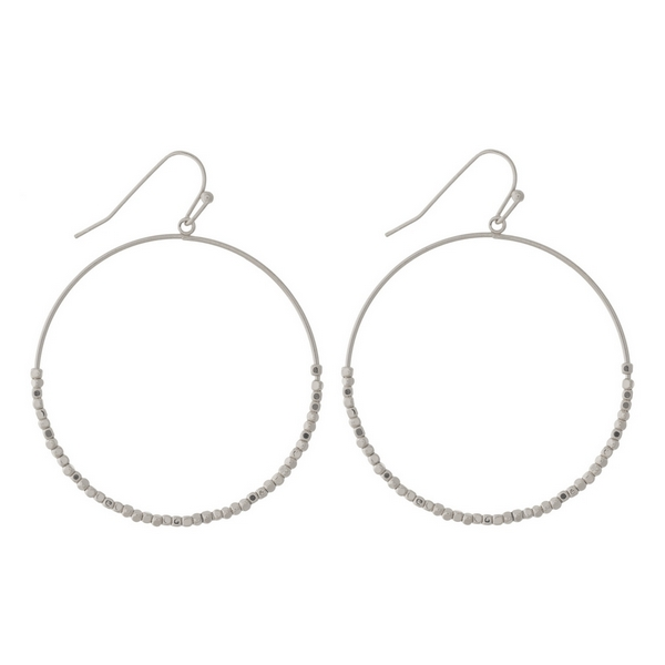 "Silver tone fishhook earrings with an open circle shape and beaded accents. Approximately 1.5"" in diameter."
