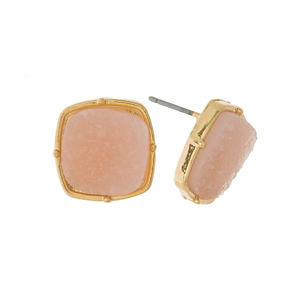 "Gold tone stud earrings with a square light pink faux druzy stone. Approximately 1/2"" in width."