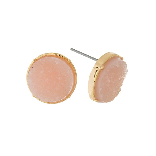 "Gold tone stud earrings with a circle light pink faux druzy stone. Approximately 1/2"" in width."
