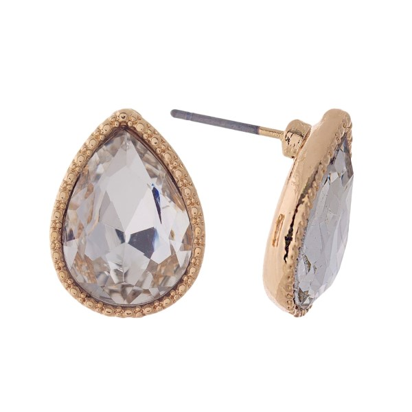 "Gold tone teardrop stud earrings with a clear rhinestone. Approximately 1/2"" in length."