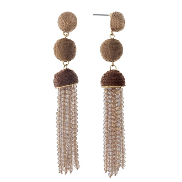 "Gold tone stud earrings with brown ombre thread wrapped beads and a champagne tassel. Approximately 3.5"" in length."