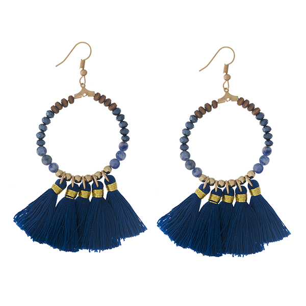 """Gold tone fishhook earrings with a natural stone beaded circle, accented with navy blue thread tassels. Approximately 3"""" in length."""